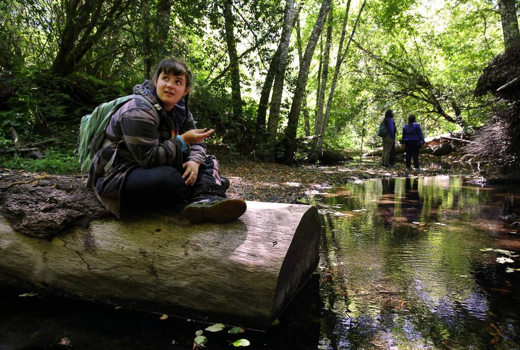 Emma Kehr looks around Willow Creek, near Duncans Mills, during a watershed exploration walk as part of the Youth Environmental 'Artivist' Summit, on Friday, July 29, 2016. (Christopher Chung/ The Press Democrat)