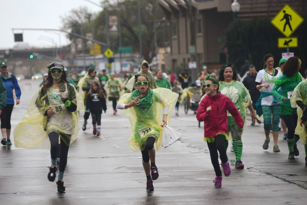 Runners heading north on Santa Rosa Avenue during the St. Patrick's Day 5K run held at Juilliard Park in downtown Santa Rosa Sunday. Proceeds from the race benefit the Santa Rosa Recreation & Parks Scholarship Fund. March 13, 2016. (Photo: Erik Castro/for The Press Democrat)
