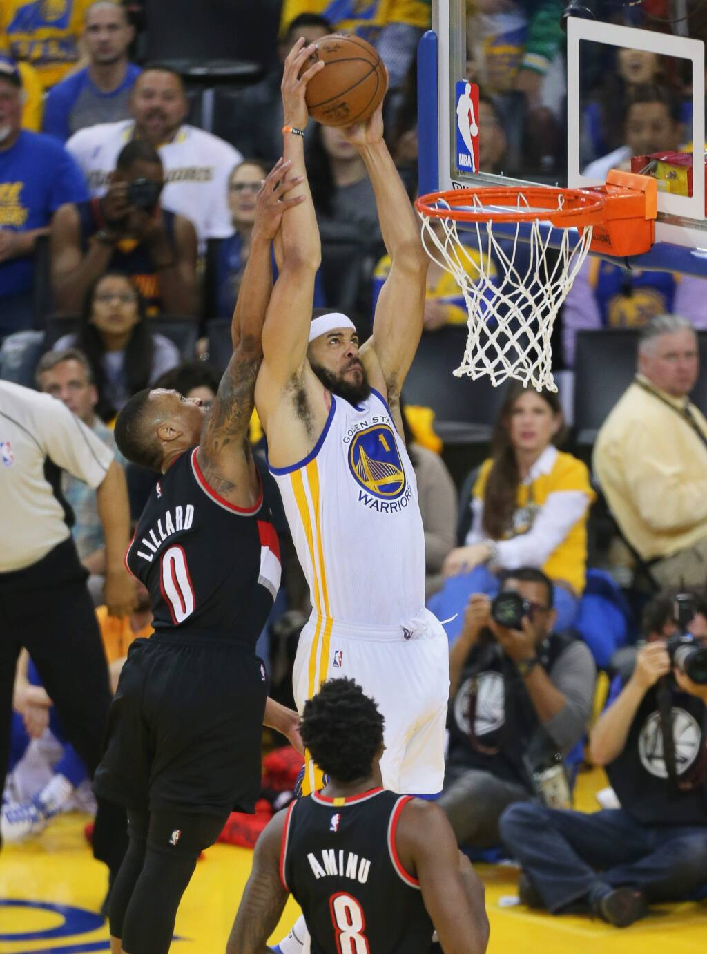 Golden State Warriors center JaVale McGee throws down a dunk over Portland Trailblazers guard Damian Lillard during Game 2 of the first round of NBA playoffs in Oakland on Wednesday, April 19, 2017. (Christopher Chung/ The Press Democrat)