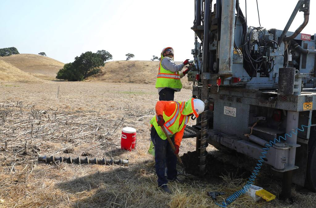 Tony Valencia, foreground, and Eddie Velasquez, of Technicon Engineering Services, Inc., collect soil samples from the area where Sonoma Clean Power's first solar power project will be installed, at the Lavio ranch property, near Petaluma on Thursday, August 31, 2017. (Christopher Chung/ The Press Democrat)