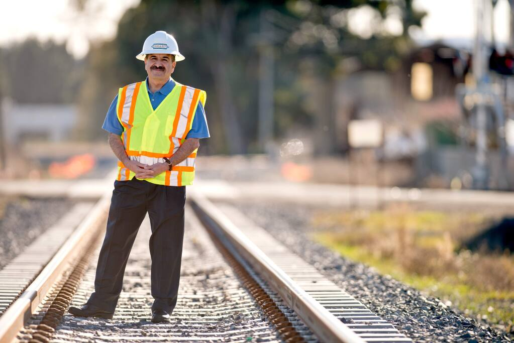 Farhad Mansourian, general manager of Sonoma-Marin Area Rail Transit, near the Adobe Lumber/Lagunitas Spur in Petaluma that serves local industry, freight, in December 2013. (Alvin A.H. Jornada / The Press Democrat)