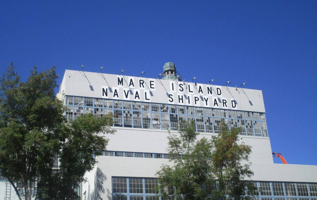 The exterior of Vallejo Mare Island's Building 680, the home of modular homebuilder Factory OS, seen here after the original Navy shipyard signage was refurbished in 2015. (courtesy of Keadjian Associates)