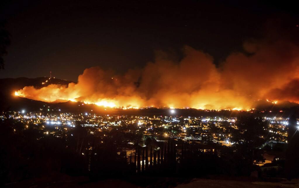 FILE - In this Oct. 31, 2019, file photo, smoke from the Maria fire billows above Santa Paula, Calif. (AP Photo/Noah Berger, File)