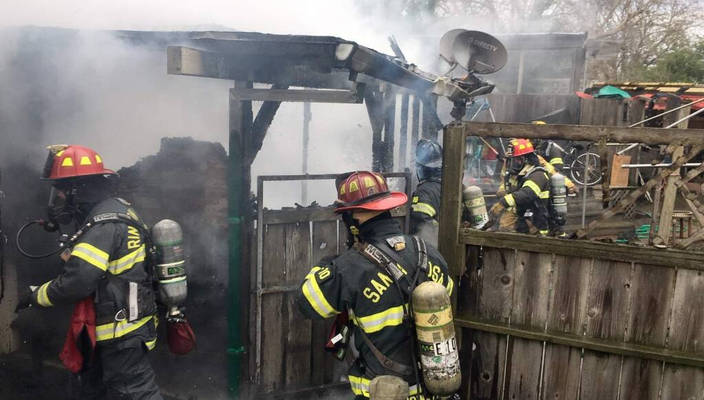 Firefighters battle a blaze at a home in southwest Santa Rosa on Tuesday, Jan. 15, 2019. (KENT PORTER/ PD)