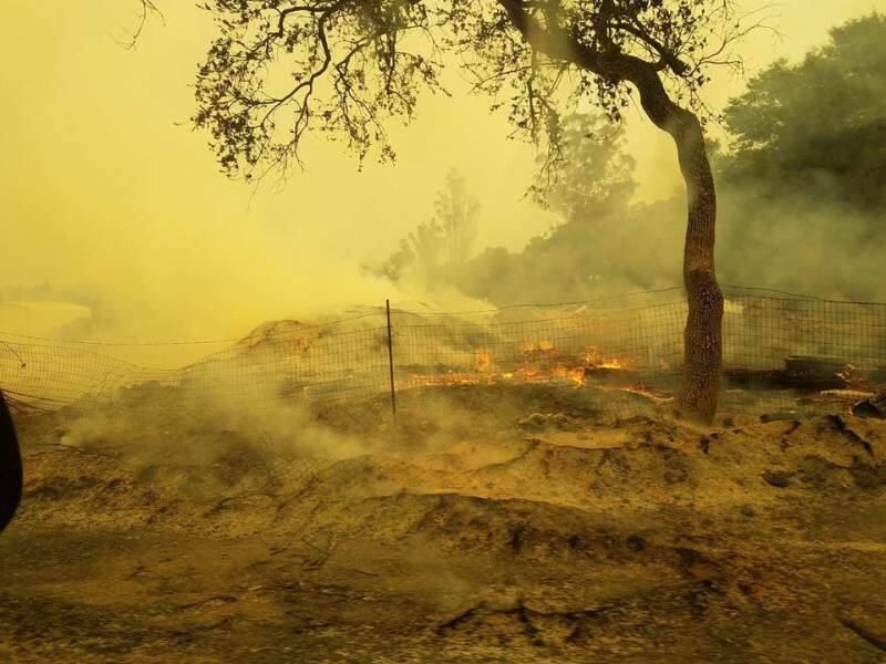 Flames smolder last October on Dunbar Road in Glen Ellen, an area of urban-wildland interface increasingly prone to wildfire.