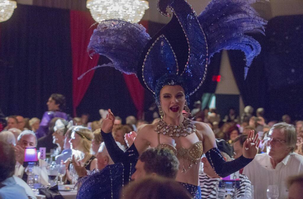 Cabaret dancers circulated throughout the dining room at the La Luz fundraiser, Noche au Moulin Rouge, at the Sonoma Veterans Hall on Saturday, August 3. (Photo by Robbi Pengelly/Index-Tribune)