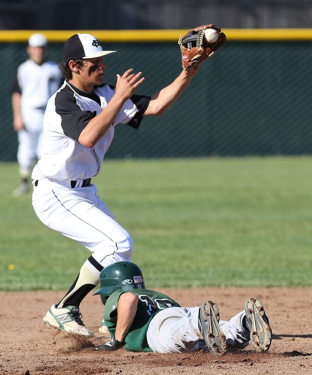 Maria Carrillo's Jake Scheiner tries to get Sonoma Valley's Jaxson Strong out at second during a 2013 game.