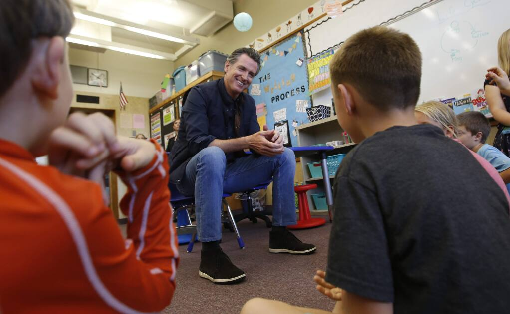 FILE - In this Aug. 21, 2019 file photo Gov. Gavin Newsom takes questions from second graders during his visit to the Paradise Ridge Elementary School in Paradise, Calif. (AP Photo/Rich Pedroncelli, Pool, File)