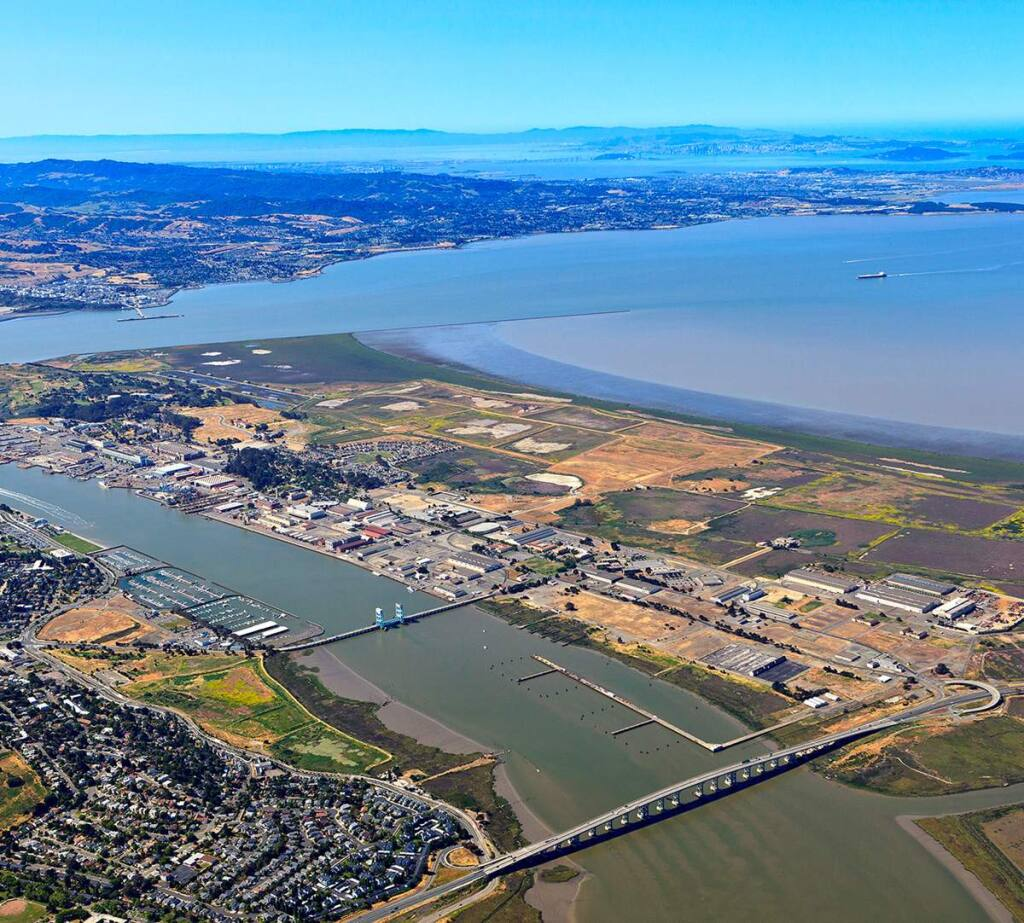 Vallejo's growing area on the west bank of the Napa River, Mare Island, seen here from the northeast, is home to more than 110 businesses with 2,500 employees. The city is looking for a developer to build 1.5 million square feet at the island's north end, seen at the lower right. (CITY OF VALLEJO)