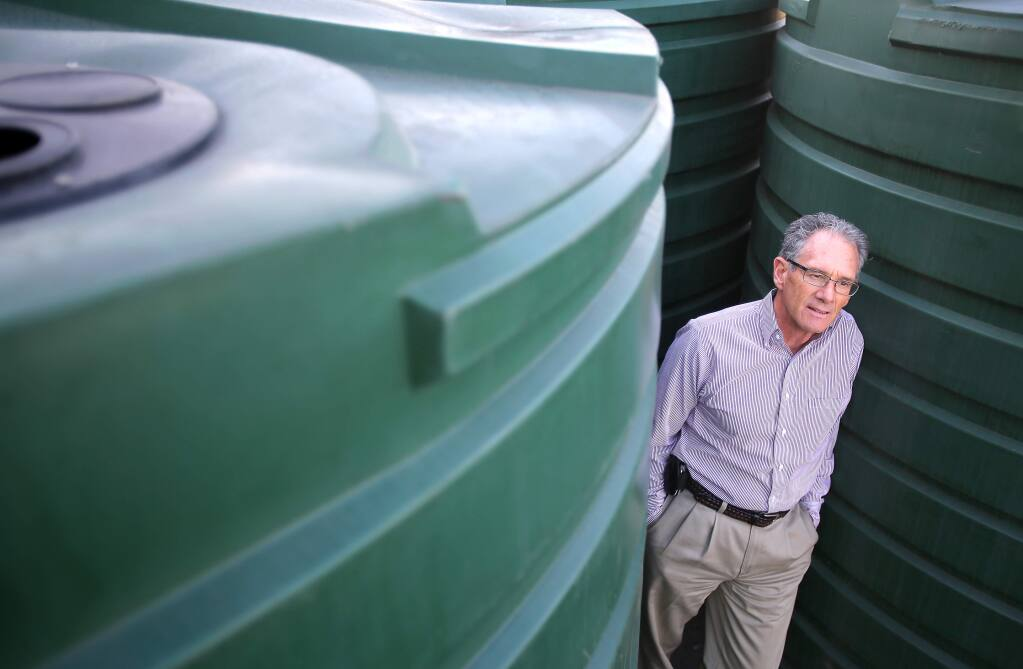 Rich Hutchison, purchasing agent for Friedman's Home Improvement, in recent years has noted an increase in sales of water storage tanks. These particular tanks can be used for both water storage and rainwater collection. (Christopher Chung / The Press Democrat, 2014)
