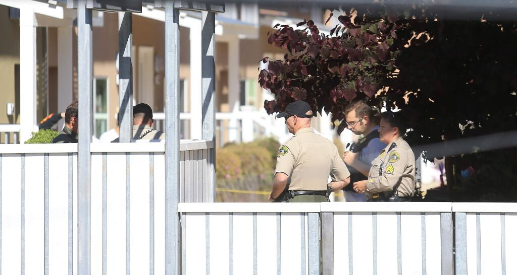 Sonoma County deputies and a CHP officer secure the scene of a deputy-involved shooting at Fife Creek Commons in Guerneville on Wednesday April 29, 2015. (KENT PORTER/ PD)