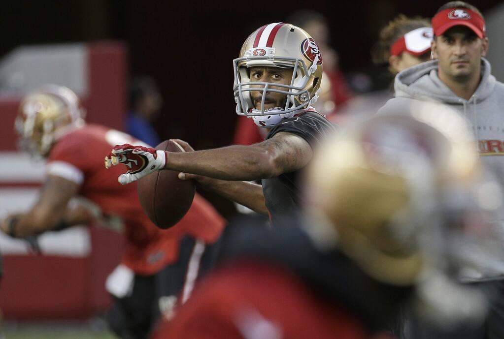 San Francisco 49ers quarterback Colin Kaepernick (7) throws a pass during the team's NFL football training camp in Santa Clara, Calif., Saturday, Aug. 1, 2015. (AP Photo/Jeff Chiu)