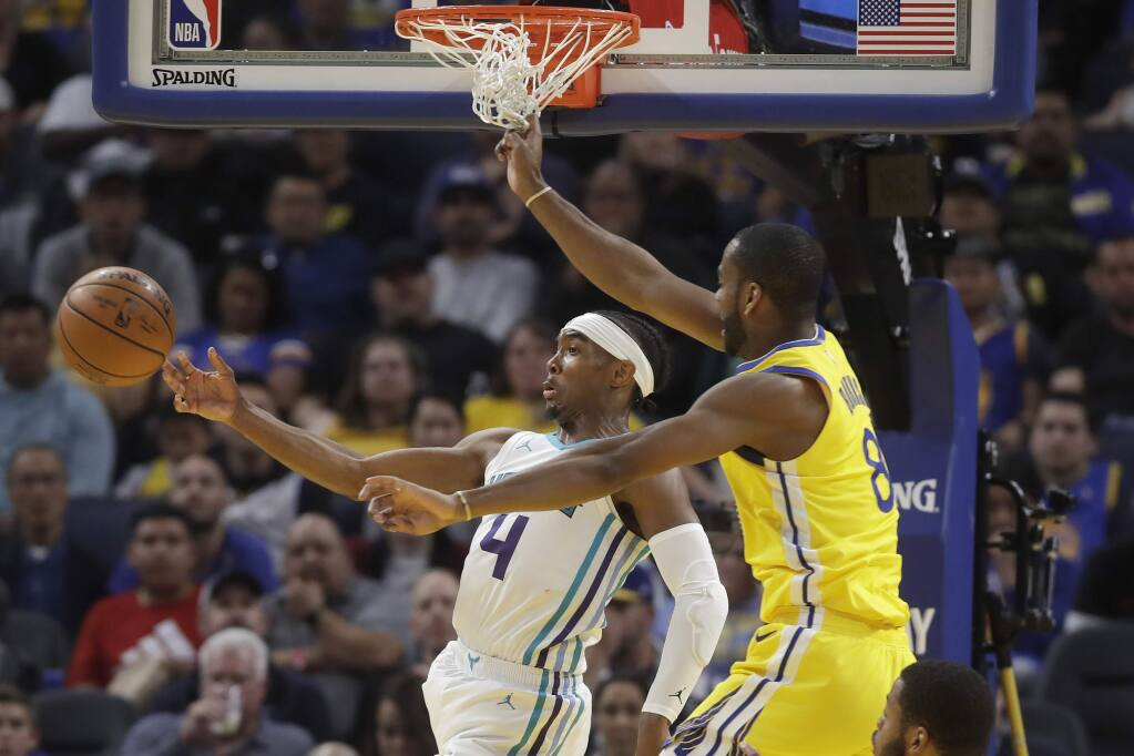 Charlotte Hornets guard Devonte' Graham passes the ball as he is defended by Golden State Warriors guard Alec Burks during the second half in San Francisco, Saturday, Nov. 2, 2019. (AP Photo/Jeff Chiu)