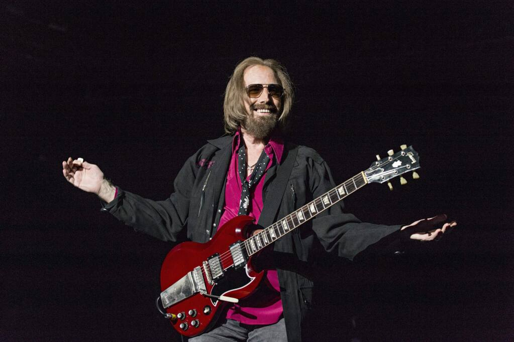 """FILE - In a Sunday, Sept. 17, 2017 file photo, Tom Petty and the Heartbreakers perform at KAABOO 2017 at the Del Mar Racetrack and Fairgrounds, in San Diego, Calif. A California real estate agent and self-proclaimed """"super fan"""" says he's extended an offer to buy the Florida home of Petty. Kevin Beauchamp tells The Gainesville Sun he quickly made an offer of $175,000 for the nearly 1,200-square-foot (111-sq. meter) home after seeing the home's current owner Brandy Clark mention on a Petty Facebook fan club that she might sell it. (Photo by Amy Harris/Invision/AP, File)"""