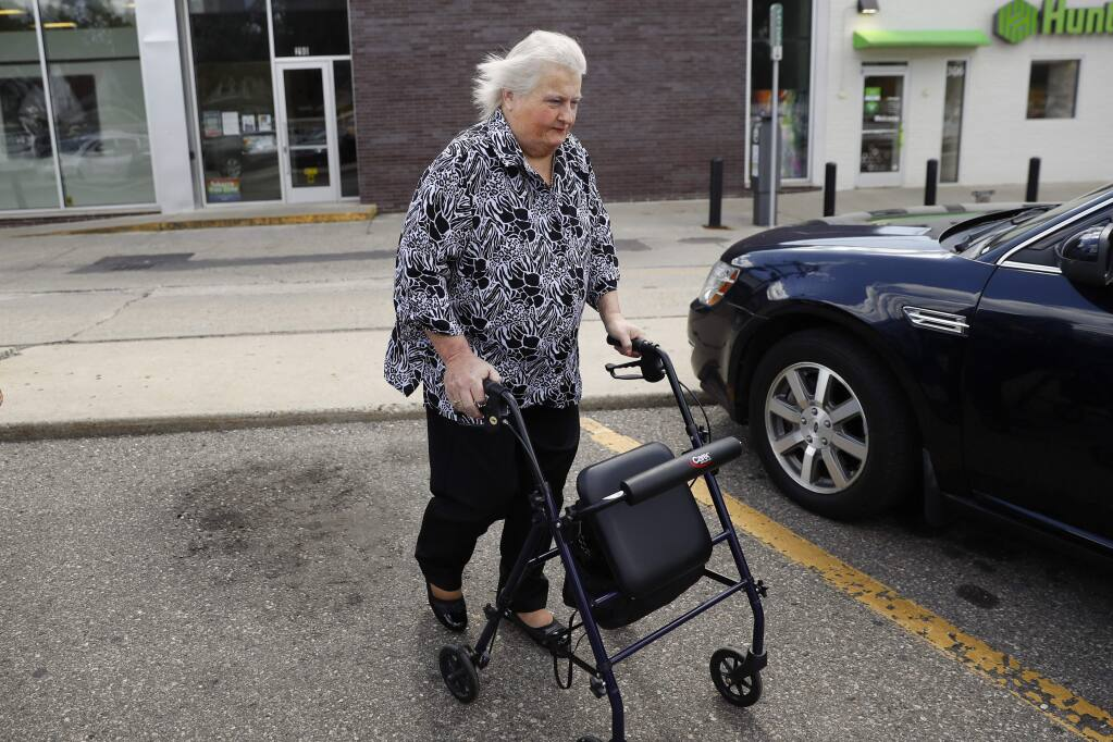 Aimee Stephens walks to her car in Ferndale, Mich., Wednesday, Aug. 28, 2019. The Supreme Court will hear Stephens' case Oct. 8 over whether federal civil rights law that bars job discrimination on the basis of sex protects transgender people. Other arguments that day deal with whether the same law covers sexual orientation. (AP Photo/Paul Sancya)