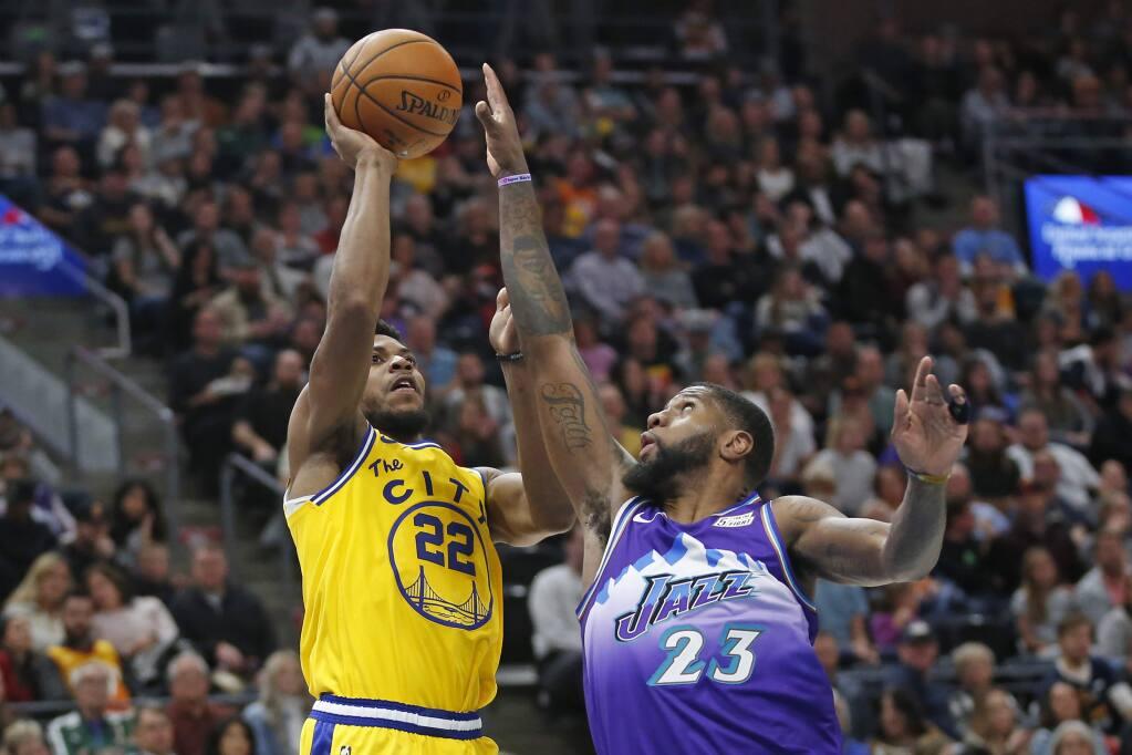 Golden State Warriors forward Glenn Robinson III shoots as Utah Jazz forward Royce O'Neale defends in the first half Friday, Nov. 22, 2019, in Salt Lake City. (AP Photo/Rick Bowmer)