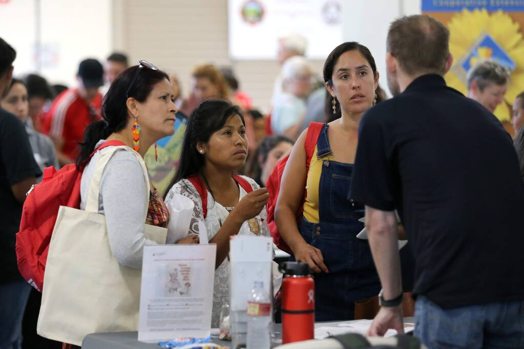 Irma Garcia, left, Cristina Ramirez, center, and Gabriela Orantes to Brian Branley of the American Red Cross speak during the Sonoma Ready Day event at the Sonoma County Fairgrounds in Santa Rosa on Sunday, September 8, 2019. (BETH SCHLANKER/ The Press Democrat)