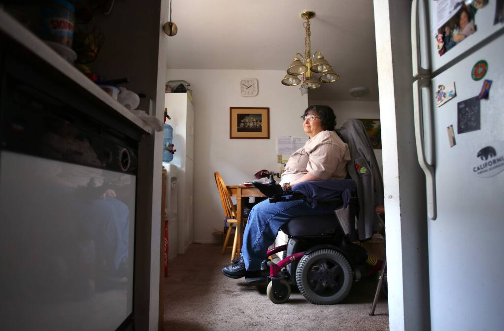 Kim Orellana, who is confined to a wheelchair and suffers from diabetes and multiple sclerosis, was told by the new owners of Casa de Sonoma apartments, where she lives with her daughter, Alicia, that she needs to move out by February so that the complex can be renovated. Orellana has lived in the apartment for six years, and has had trouble finding an affordable place to live in Sonoma.(Christopher Chung/ The Press Democrat)