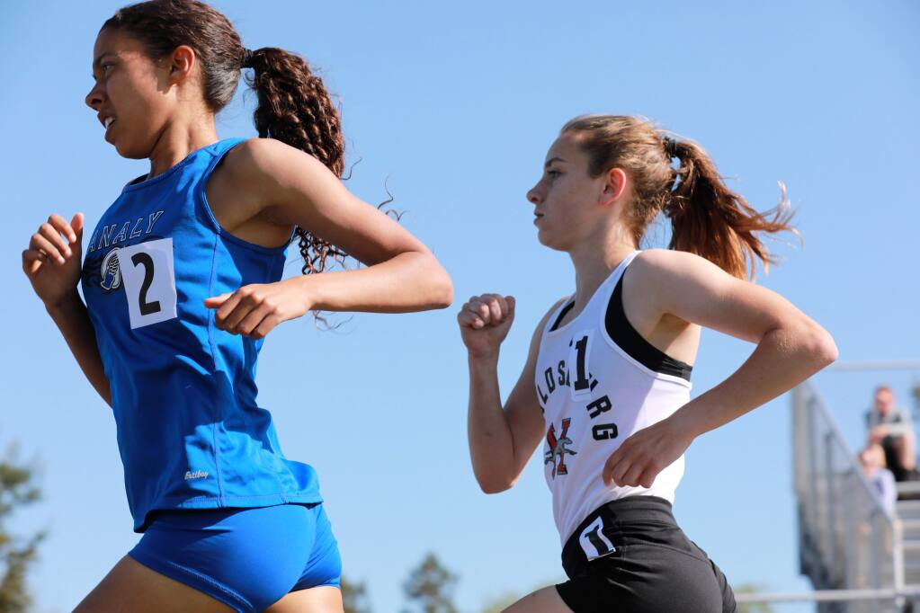 Gabrielle Peterson of Healdsburg High School trails Sierra Atkins of Analy High School midway in the 1,600-meter race during the North Bay League track and field finals at Montgomery High School on Saturday, May 3, 2019. Peterson won the race. (Photo by Darryl Bush / For The Press Democrat)