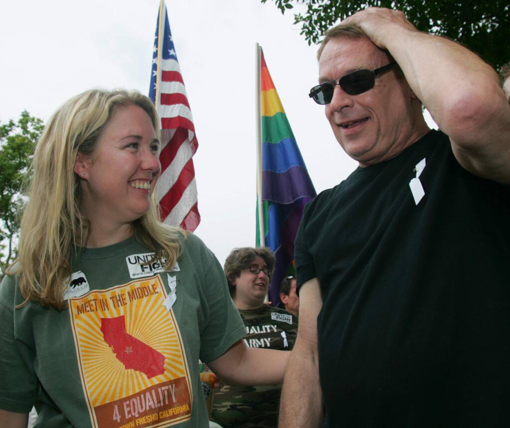 Organizer Robin Megehee and Activist Cleve Jones share a moment during a Meet in the Middle 4 Equality rally in Fresno, Calif. on Saturday, May 30, 2009 to protest the California Supreme Court decision to uphold Proposition 8 which bans gay marriage in the state Constitution. (AP Photo/Gary Kazanjian)