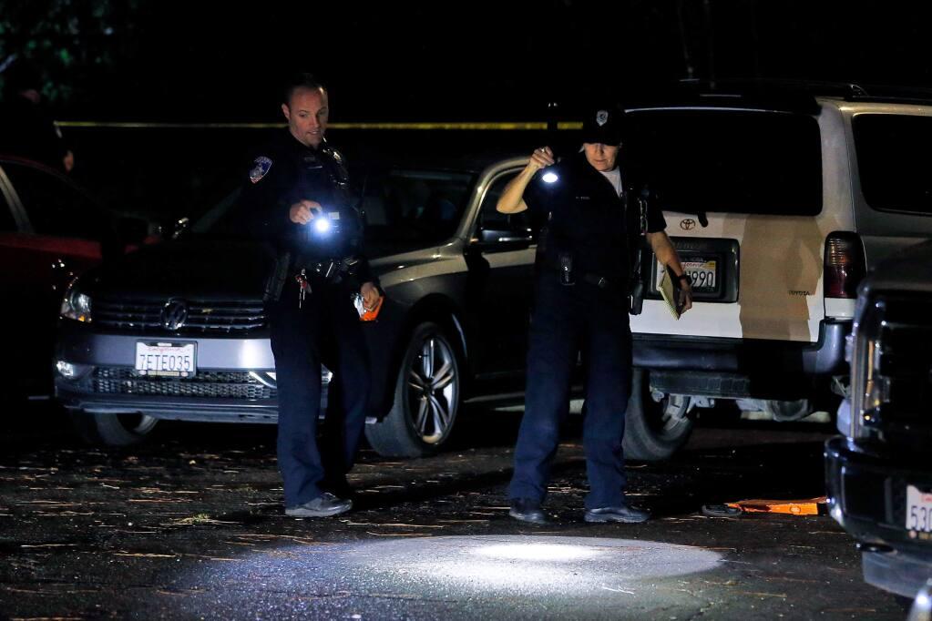 Santa Rosa Police officers investigate the scene of a shooting that occurred on Grand Avenue in Santa Rosa, California, on Monday, Dec. 2, 2019. (ALVIN JORNADA/ PD)