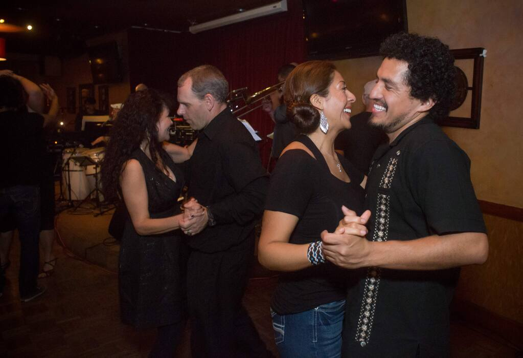 Guests dance the salsa to Edgardo Y Candela during Sultry Salsa Nights at the Flamingo Conference Resort and Spa in Santa Rosa, Calif., Saturday, April 9, 2016. (Jeremy Portje / For The Press Democrat)