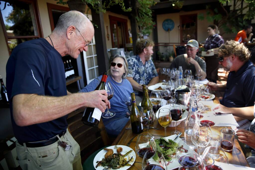 Dan Goldfield, Bob Cabral, Mike Sullivan, John Sims, and Jeff Stewart taste wines during a lunch for former colleagues from Hartford Court at Backyard in Forestville, on Monday, July 11, 2016. (BETH SCHLANKER/ The Press Democrat)