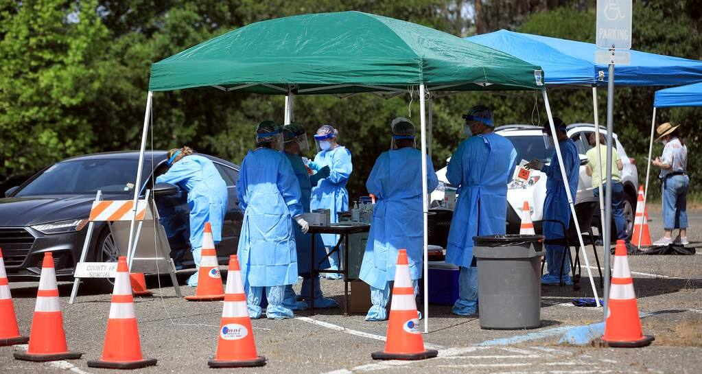 The Sonoma County Department of Public Health screened and swabbed 200 health care professionals, Saturday, April 25, 2020 in Santa Rosa as they screen for the coronavirus. (Kent Porter / The Press Democrat)