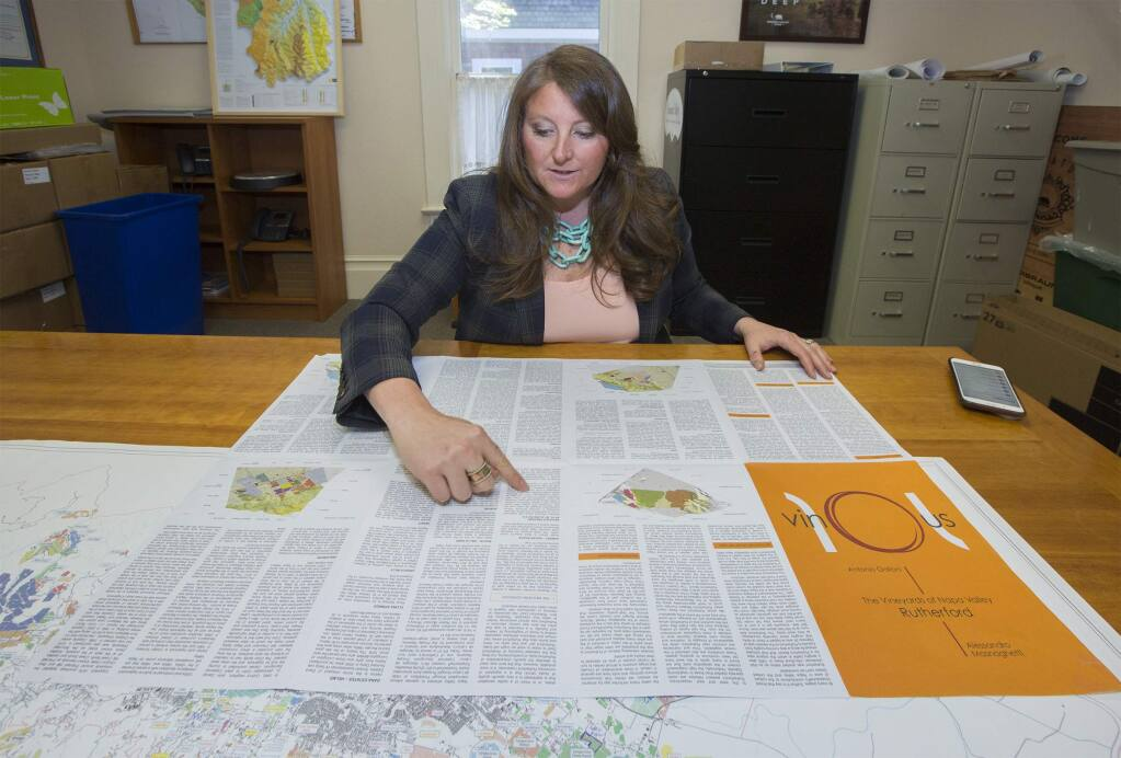 SVVGA executive director Maureen Cottingham shows how every vineyard will have a biographical paragraph. The Sonoma Valley Vintners & Growers Alliance have mapped every single vineyard of at least a quarter acre in Sonoma Valley. (Photo by Robbi Pengelly/Index-Tribune)