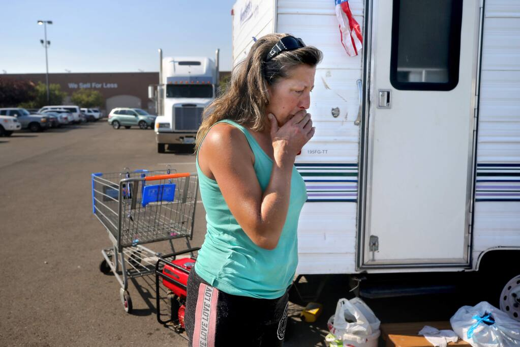 Tammy H., a Windsor resident and Kincade fire evacuee, becomes emotional as she stands in the Walmart parking lot in Rohnert Park on Tuesday, October 29, 2019. (BETH SCHLANKER/ The Press Democrat)