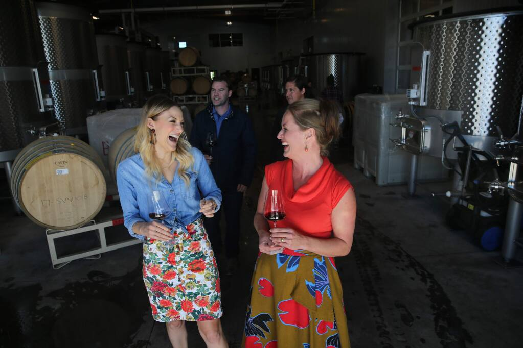 Hospitality manager Nicole Yasinsac, right, leads a tour with guests Katie Fay, left, a hospitality manager at Lambert Bridge Winery, Danny Fay, rear left, a general manager of Kanzler Family Vineyards, and winemaker William Weese, rear right, through the production area at Grand Cru Custom Crush in Windsor on Thursday, October 25, 2018. (BETH SCHLANKER/ The Press Democrat)