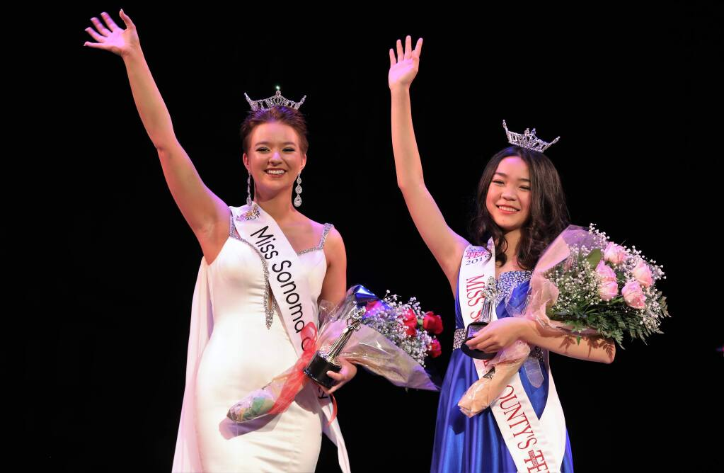 Newly crowned Miss Sonoma County 2019, Rhiannon Jones (left) and Miss Sonoma County's Outstanding Teen 2019 Emma Chen wave to the audience the 73rd Annual Miss Sonoma County Scholarship competition at Spreckels Performing Arts Center in Rohnert Park on Saturday, March 2, 2019. (WILL BUCQUOY/ FOR THE PD)