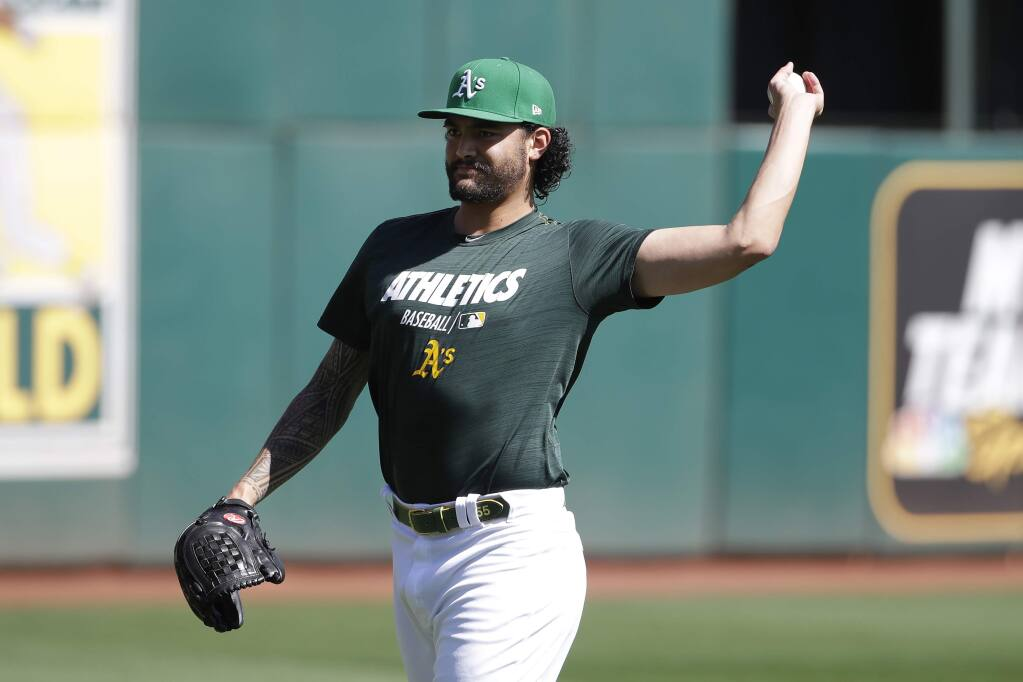 Oakland Athletics pitcher Sean Manaea throws during practice in Oakland, Tuesday, Oct. 1, 2019. The Athletics are scheduled to face the Tampa Bay Rays in an American League wild-card game Wednesday, Oct. 2. (AP Photo/Jeff Chiu)