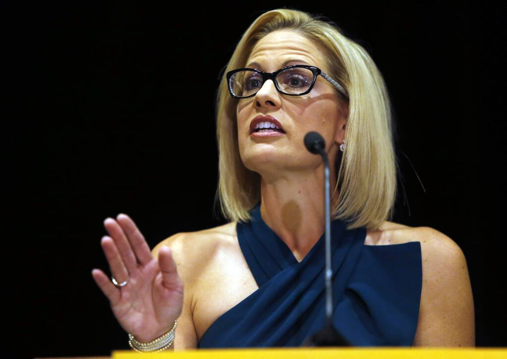 U.S. Sen.-elect Kyrsten Sinema, D-Ariz., speaks after being declared the winner over Republican challenger U.S. Rep. Martha McSally, Monday, Nov. 12, 2018, in Scottsdale, Ariz. Sinema won Arizona's open U.S. Senate seat in a race that was among the most closely watched in the nation, beating McSally in the battle to replace GOP Sen. Jeff Flake. (AP Photo/Rick Scuteri)