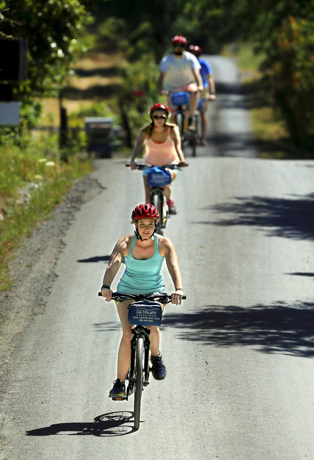 Sara Babineau leads a group of friends from Wisconsin on a bike ride to Iron Horse Vineyards on their pedal n' paddle trip with Gateway Adventures. (JOHN BURGESS/The Press Democrat)