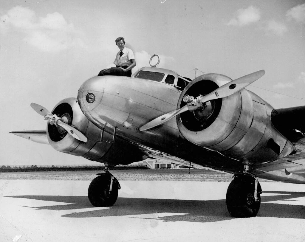 This 1937 photo shows Amelia Earhart before takeoff in Miami for an attempted round-the-world flight. Earhart and her navigator, Fred Noonan, disappeared in the South Pacific in July 1937, while on one of the last legs of that journey. (The Miami Herald via AP)