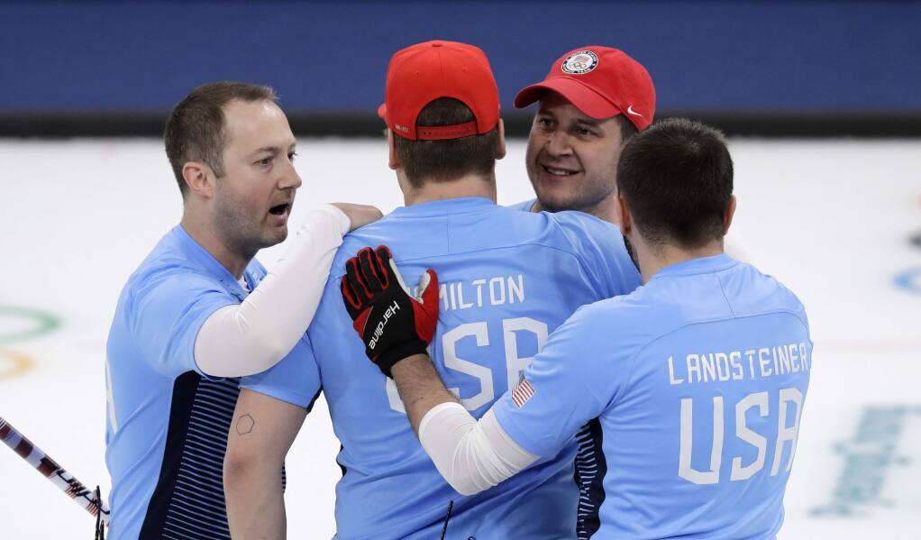 The United States team celebrates after defeating Canada during the men's curling semifinal match at the 2018 Winter Olympics in Gangneung, South Korea, Thursday, Feb. 22, 2018. (AP Photo/Aaron Favila)