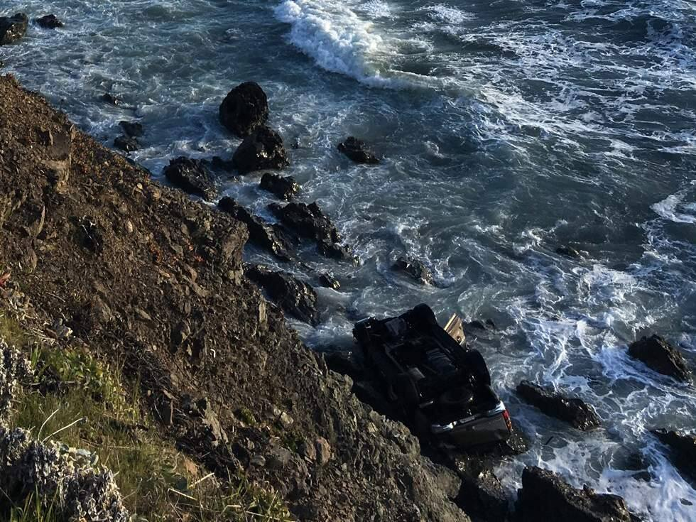 A GMC careened off a Mendocino Coast cliff, killing two adults and three children, Monday, March 26, 2018. (CHP)
