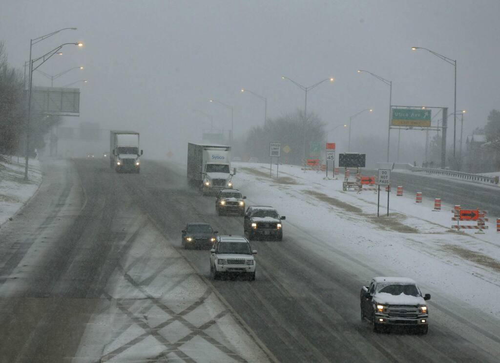 Traffic makes it way on the Broken Arrow Expressway headed West in the snow in Tulsa, Okla., Wednesday, Feb. 5, 2020. (Stephen Pingry/Tulsa World via AP)