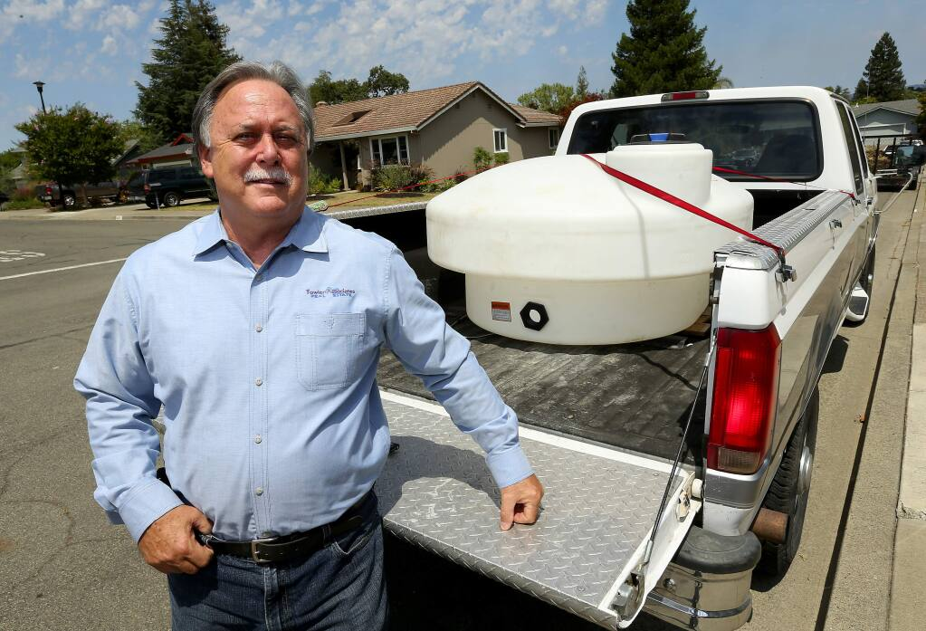Healdsburg City Councilman Gary Plass bought a 300-gallon container for hauling highly treated recycled water from the sewage treatment plant at no charge to city residents for use in their landscaping. (JOHN BURGESS / The Press Democrat)