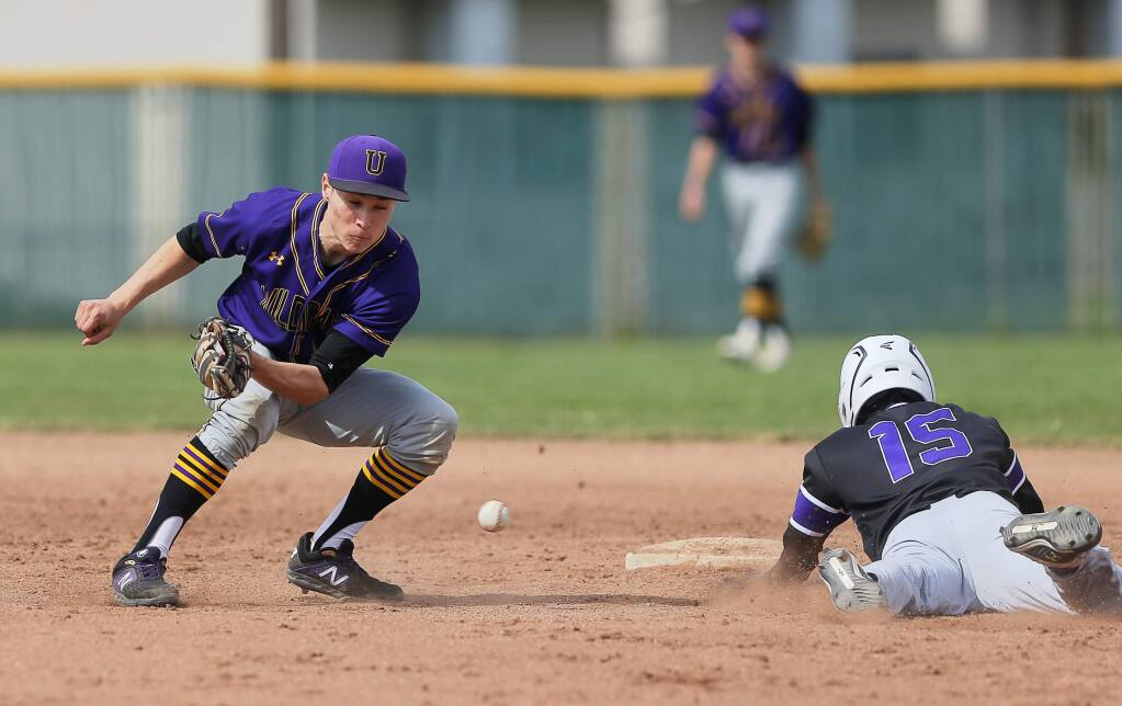 Ukiah's Adrian Villalpondo is unable to handle the throw to second as Sequioia's Andre Pereira safely tags the base, during the A.L. Rabinovitz Tournament in Santa Rosa on Tuesday, March 19, 2019. (Christopher Chung / The Press Democrat)