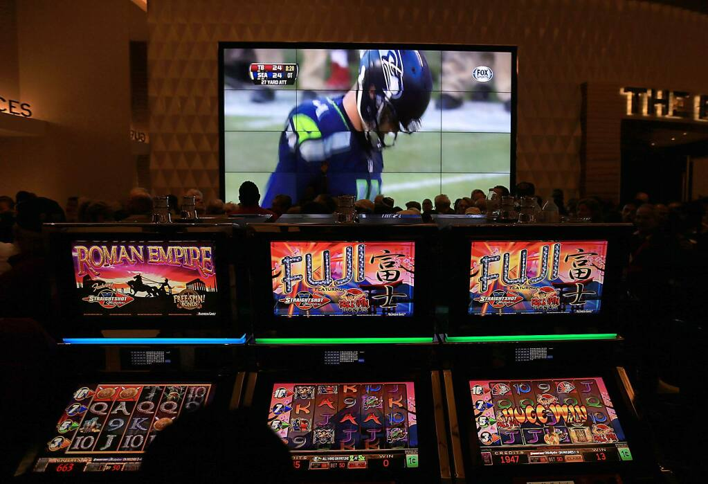 Video slots and big screen televisions at the Graton Resort and Casino in 2013. (KENT PORTER/ PD)