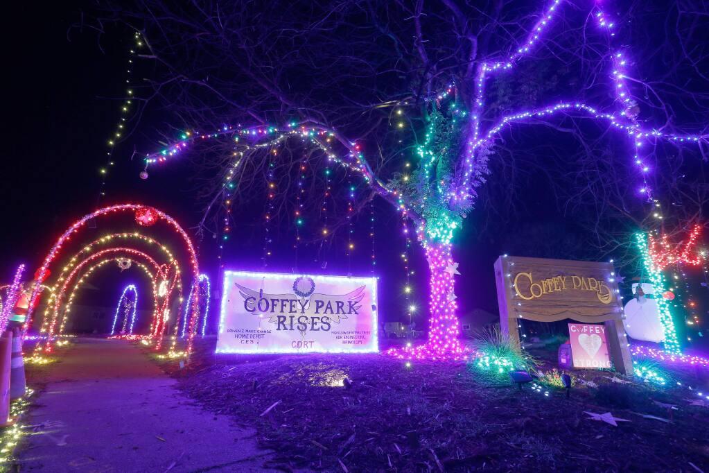 Christmas lights decorate the entrance to the Coffey Park neighborhood on the corner of Hopper Avenue and Coffey Lane, in Santa Rosa, California, on Thursday, December 6, 2018. (Alvin Jornada / The Press Democrat)