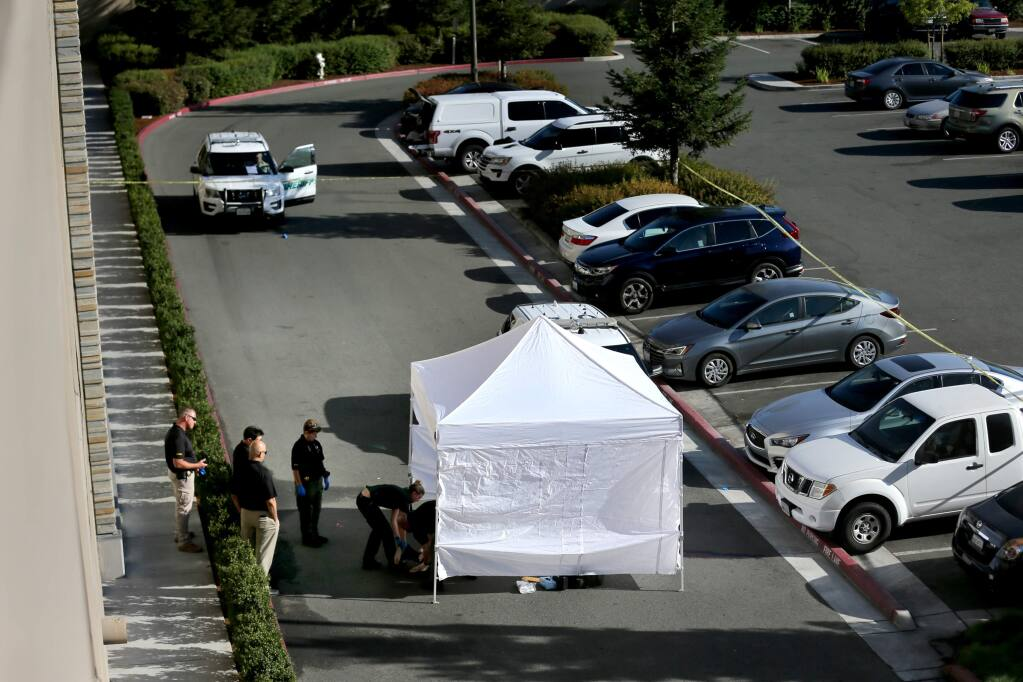 Members of the Sonoma County Sheriff's Office investigate a death just outside the parking garage at the Graton Resort and Casino in Rohnert Park on Monday, Sept. 9, 2019. (BETH SCHLANKER/ PD)