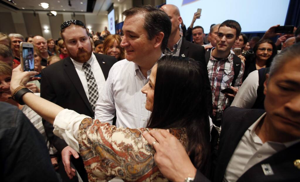 Republican candidate for president Sen. Ted Cruz greets supporters after speaking at a rally on the campus of Boise State University in Boise, Idaho, Saturday, March 5, 2016. (Joe Jaszewski/Idaho Statesman via AP)