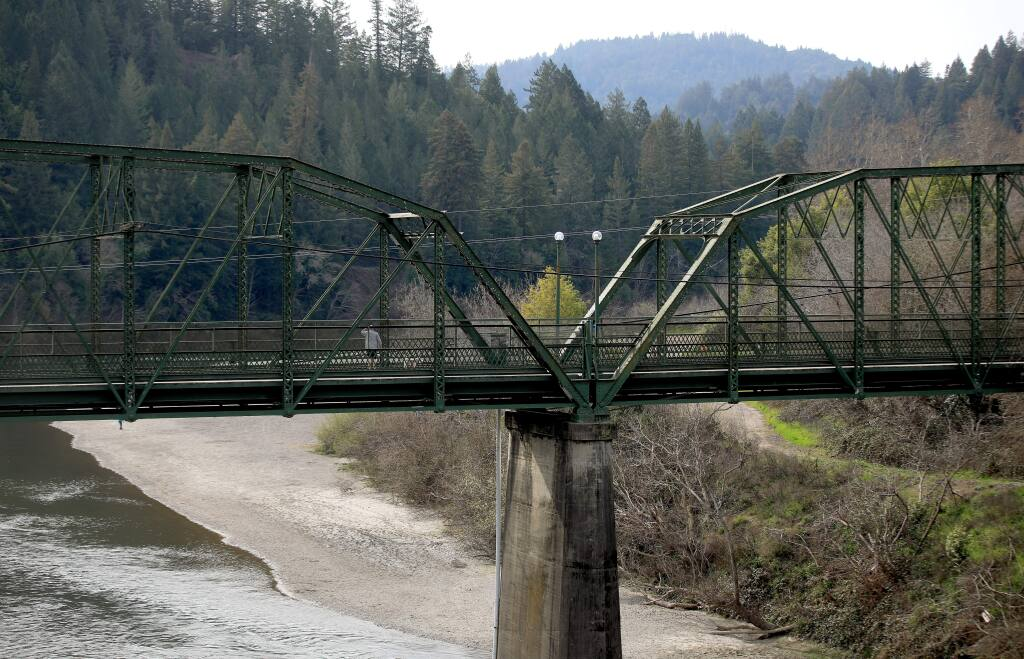 A year ago, the Russian River was just under the walkway of the Guerneville pedestrian bridge thanks to a storm that dropped nearly two feet of rain on the watershed. On Wednesday Feb, 20, 2020, the river is running very low due to no February rain. (Kent Porter /The Press Democrat)
