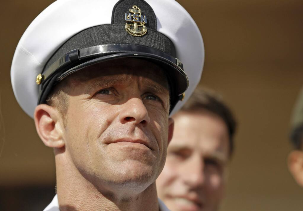 FILE - In this July 2, 2019, file photo, Navy Special Operations Chief Edward Gallagher leaves a military court on Naval Base San Diego. The war crimes case against the Navy SEAL not only cost the Navy secretary his job. It dragged an elite military force whose ethos calls for its warriors to be quiet professionals into a very public and divisive political firestorm. (AP Photo/Gregory Bull, File)