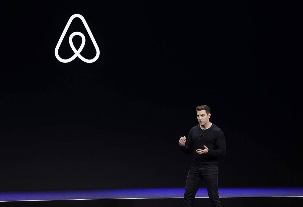 FILE - In this Feb. 22, 2018, file photo Airbnb co-founder and CEO Brian Chesky speaks during an event in San Francisco. Airbnb is laying off 25% of its workforce as it confronts a steep decline in global travel due to the new coronavirus. In a letter to employees, Tuesday, May 5, 2020, Chesky said the company is letting 1,900 of its 7,500 workers go and cutting businesses that don't directly support home-sharing, like its investments in hotels and movie production.(AP Photo/Eric Risberg, File)