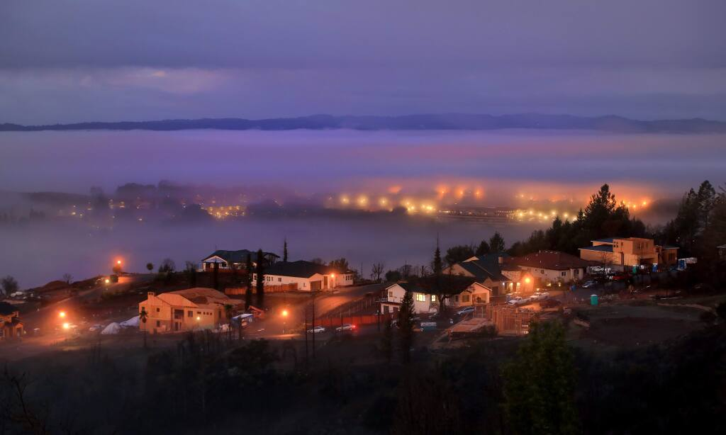 Form Rincon Ridge West, Crown Hill Drive is busy with new construction from the devastation wrought by the 2017 Tubbs fire, Thursday, Jan 9, 2020 as fog hugs Foutnaingrove above the Santa Rosa Plain at sunrise. Memories of the 2017 wildfires and 2019's Kincade fire were on some voters' minds as they weighed Measure G, a half-cent sales tax to bolster firefighting resources. (Kent Porter / The Press Democrat) 2020