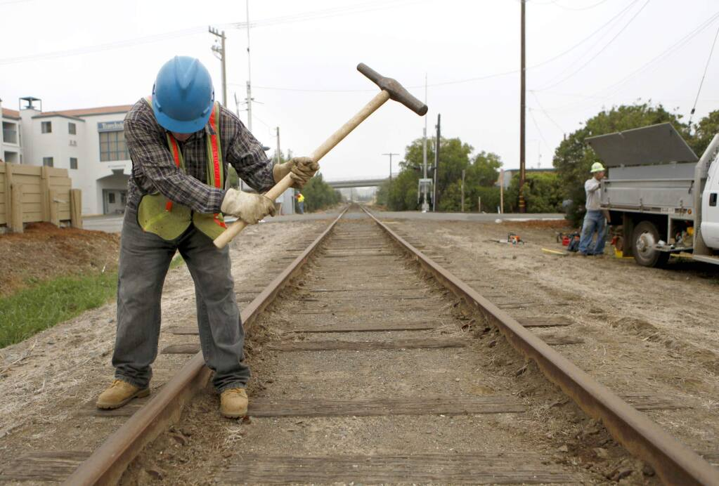 Jorge Jimenez, a worker with Northwestern Pacific Railroad Company, hammers spikes as he does maintenance on the railroad on Tuesday, October 19, 2010, in Novato, California. (BETH SCHLANKER/ The Press Democrat)